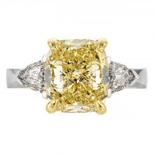 4.26ct Cushion Fancy Yellow Diamond Three-Stone Ring
